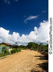 Unmade earth road in a village Dominican republic