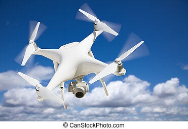 Unmanned Aircraft System Quadcopter Drone In The Air.