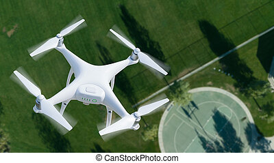 Unmanned Aircraft System (UAV) Quadcopter Drone In The Air Over A Park.