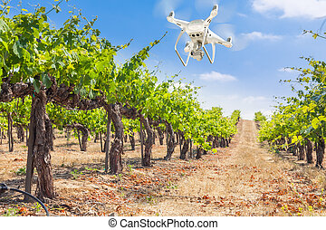Unmanned Aircraft System (UAV) Quadcopter Drone In The Air Over Grape Vineyard Farm.