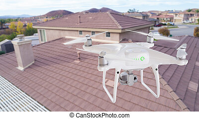 Unmanned Aircraft System (UAV) Quadcopter Drone In The Air ...