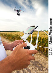 Unmanned copter. Man controls quadrocopter flight. - ...