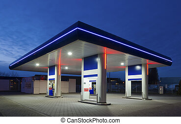 gas station at night - unmanned gas station at night in the...