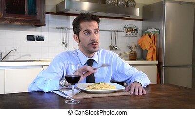 unmarried businessman eating pasta