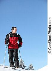 uno, uomo, sciare
