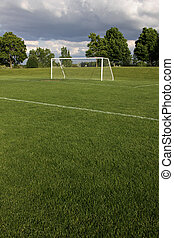 Unoccupied Soccer Field - A view of a net on a vacant soccer...