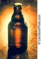 Unopened unlabeled bottle of beer