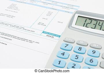 Unpaid utility bill and calculator over it