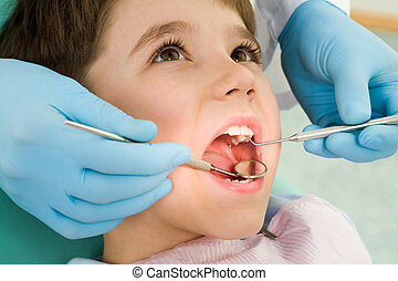 Unpleasant procedure - Close-up of little boy opening his...