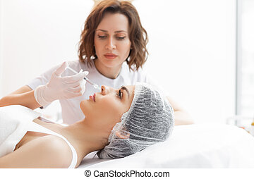 Nice attractive woman receiving botox injections in the face