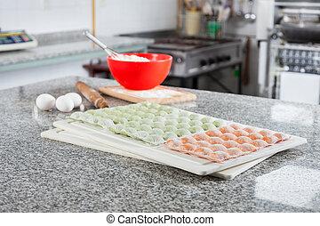 Unprepared Ravioli Pasta At Counter In Commercial Kitchen