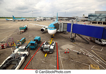 unreal airliner parked at airport. boarding passengers tube. service technician