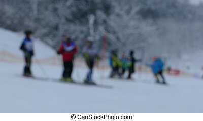 Unrecognisable skiers skiing in the slope of ski resort....
