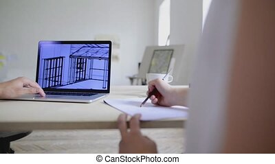 Unrecognizable architect and designer working on a project.