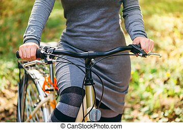 Unrecognizable attractive young adult female with vintage retro bike