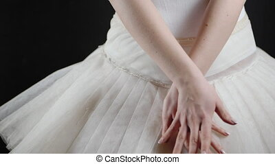 Unrecognizable ballerina in white tutu dress. Black...