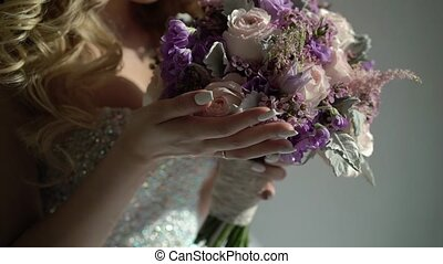 Unrecognizable bride with bouquet