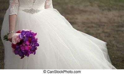 Unrecognizable bride with bouquet