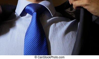 unrecognizable businessman adjusts his suit. -...