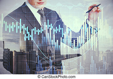 Unrecognizable businessman drawing forex charts on virtual screen.