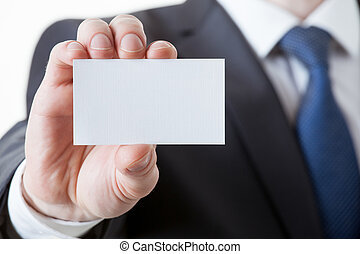 Unrecognizable businessman holding a visiting card