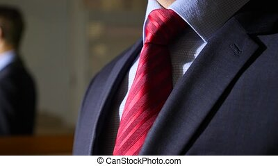 unrecognizable businessman takes off his tie. 4k, slow motion. details, close-up