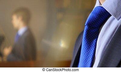unrecognizable businessman takes off his tie. 4k, slow...