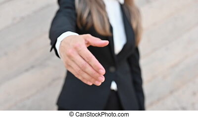 Unrecognizable Businesswoman extending hand for handshake offer collaboration in office, introduction concept, close up, slow motion. High quality FullHD footage