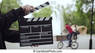 unrecognizable, clapperboard, homme, outdoors.,...
