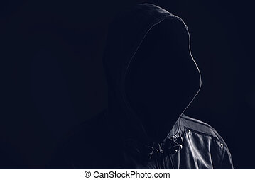 Unrecognizable faceless spooky hooded hooligan