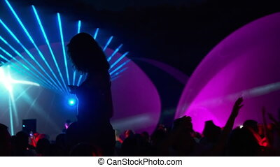 Unrecognizable female dancing during party - Silhouette of ...