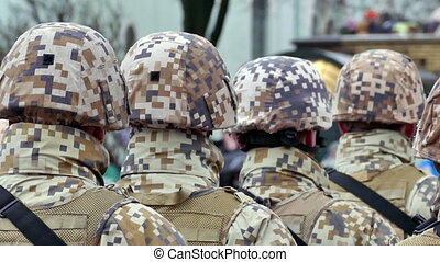 Unrecognizable formation of soldiers from back in army...