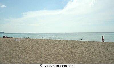 Unrecognizable girl in bikini walks along the beach clip