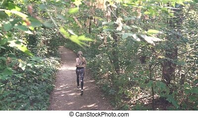 Unrecognizable Girl Runs In The Forest