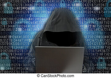 Unrecognizable hacker in front of computer – cybercrime...