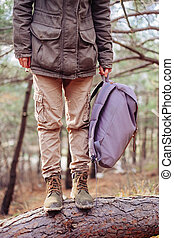 Unrecognizable hiker with backpack outdoor