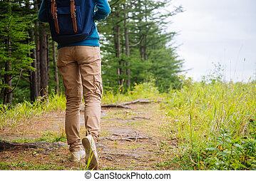 Unrecognizable hiker woman