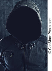Unrecognizable hooded soccer hooligan portrait, spooky faceless criminal person in jacket with hood