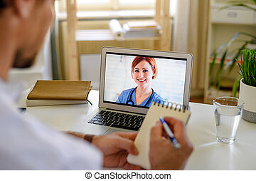 Unrecognizable man having video call with doctor at home, online consultation concept.