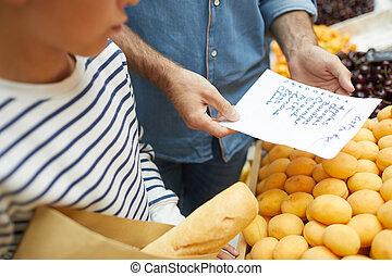 Unrecognizable Man Reading Shopping List