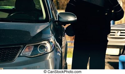 Unrecognizable man refuels his car at the filling station -...