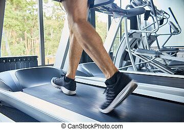 Unrecognizable Man Running on Treadmill
