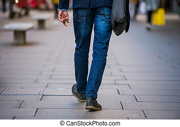 Unrecognizable manager walking in the street, rear view - ...