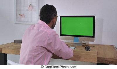 Unrecognizable men using computer indoor.