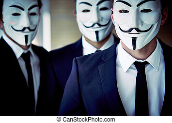 Close-up portrait of unrecognizable people wearing Guy Fawkes masks and business suits