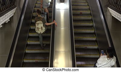 Unrecognizable people on moving staircase of Moscow metro 4K video