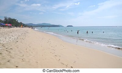 Unrecognizable people on Phuket beach, slow motion video