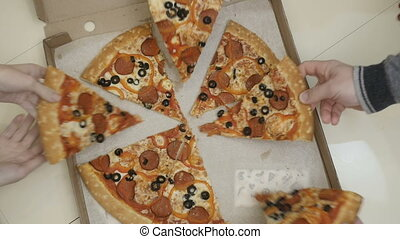 Crop unrecognizable people taking slices of pizza from box.