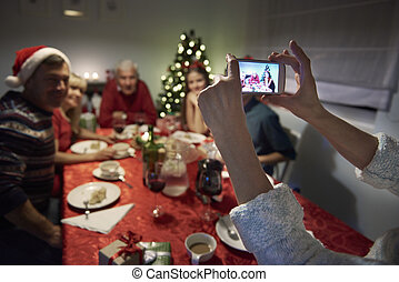 Unrecognizable person taking photography of the family