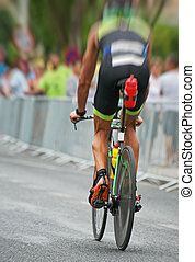 Unrecognizable professional cyclist during the bicycle competition. Back view.